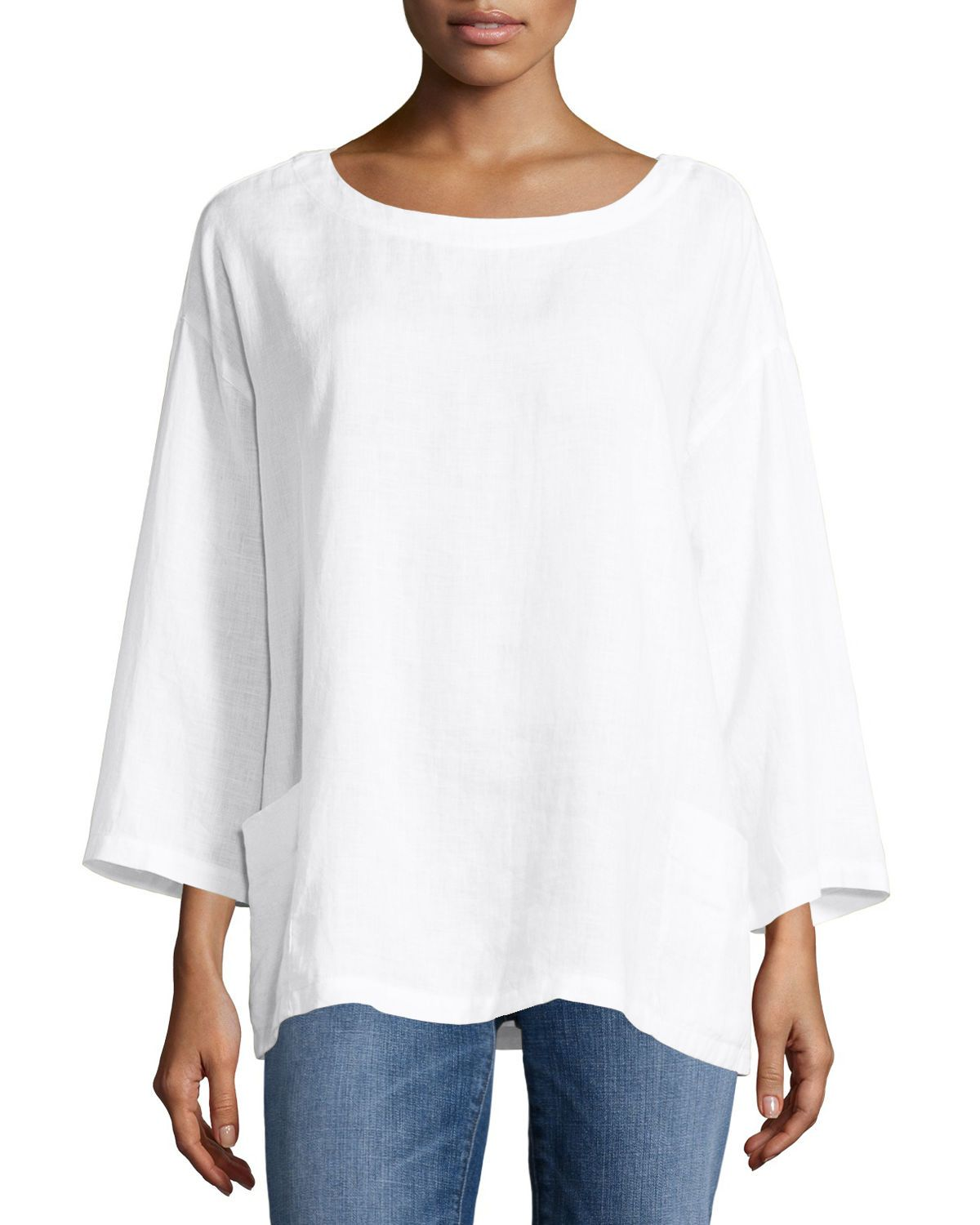 9a03f5c37ac Banded bateau neckline; button placket behind neck. Three-quarter,  drop-shoulder sleeves. Patch pockets at hip. Eileen Fisher tunic in  lightweight, organic ...