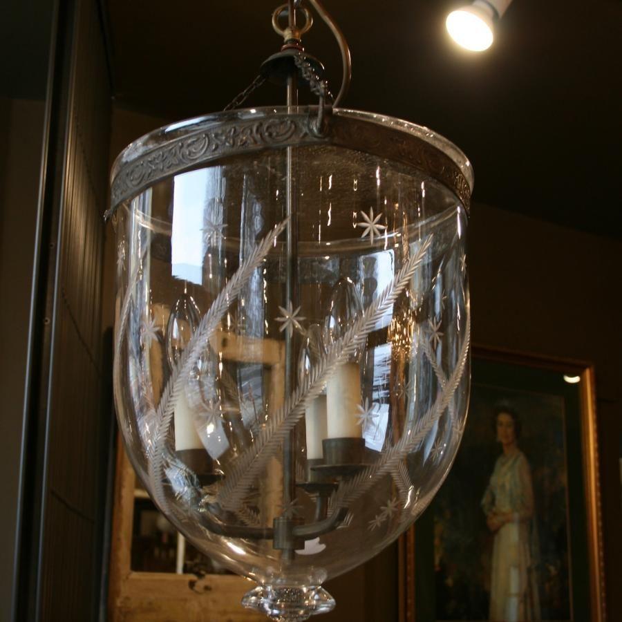 An antique glass bell jar pendant light with etched detailing an antique glass bell jar pendant light with etched detailing suspended within a decorative brass aloadofball Choice Image
