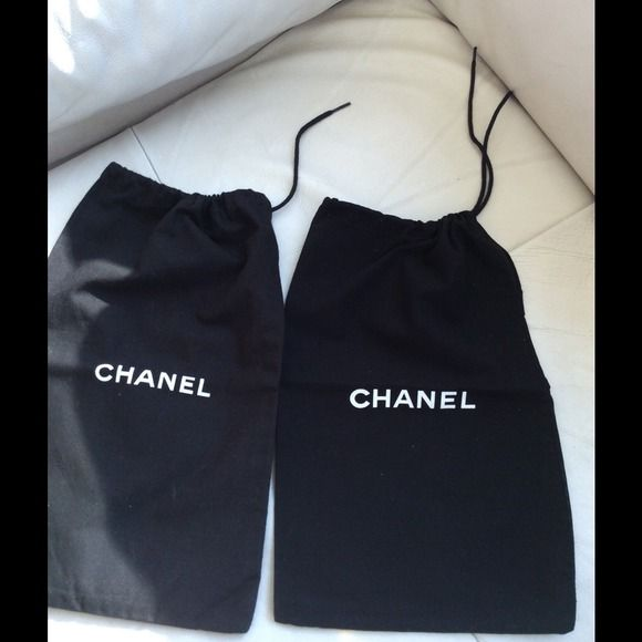 Chanel- two black drawstring dust bags 8x13 Two 8x13 draw string dust bags, never used, they came with shoes, but can be used for smaller Chanel items or not. CHANEL Accessories