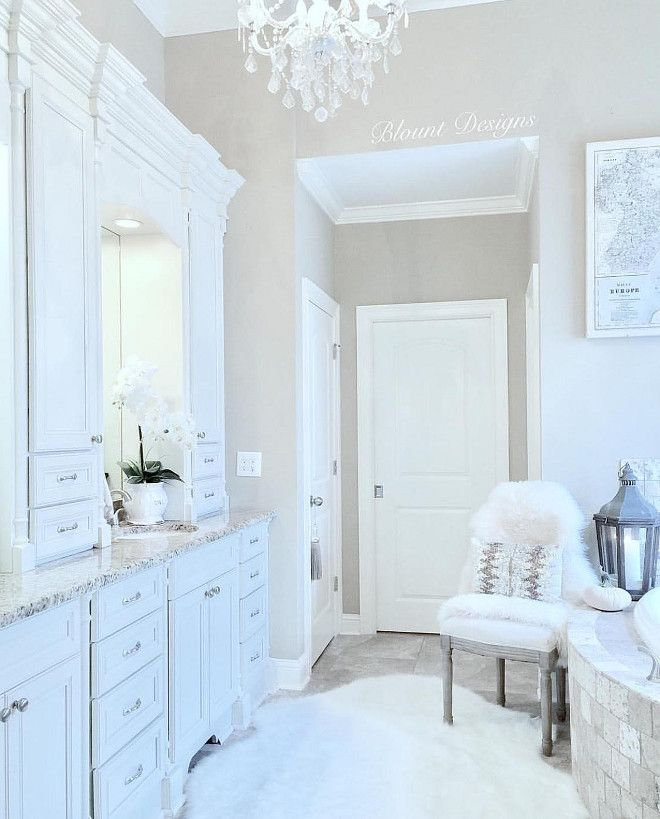 This bathroom is serene and well designed. Paint color is Sherwin ...