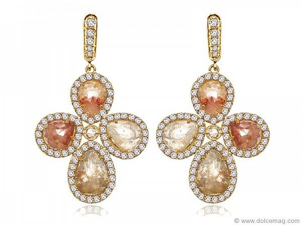 rmth with Sutra's 18-karat yellow gold natural rough diamond earrings.