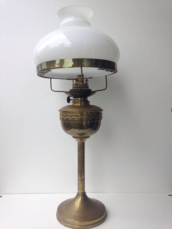 Art deco brass oil lamp with milk glass shade