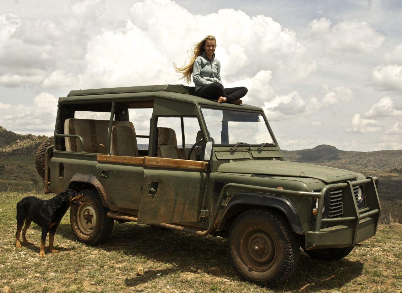 Posing on Land Rover in Kenya ★ App for Land Rover Warning