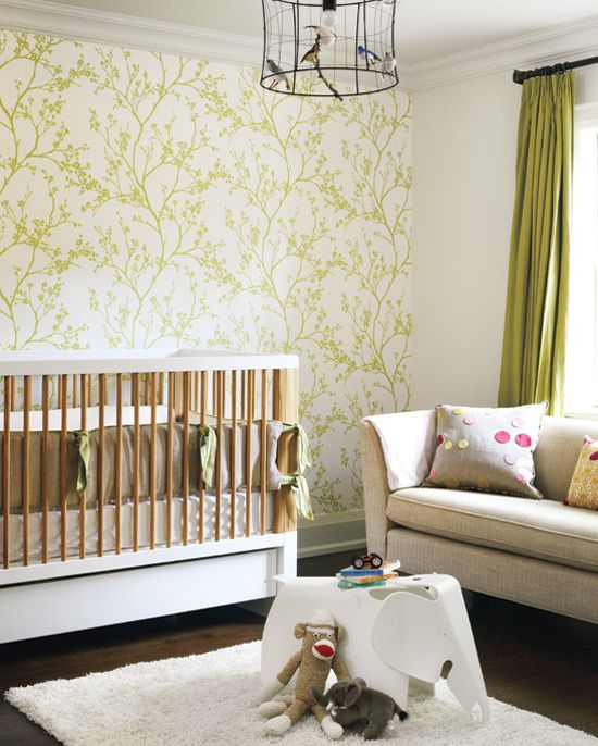Now this is a beautiful nursery! Understated yet interesting with wallpaper, green drapes and bird cage lighting