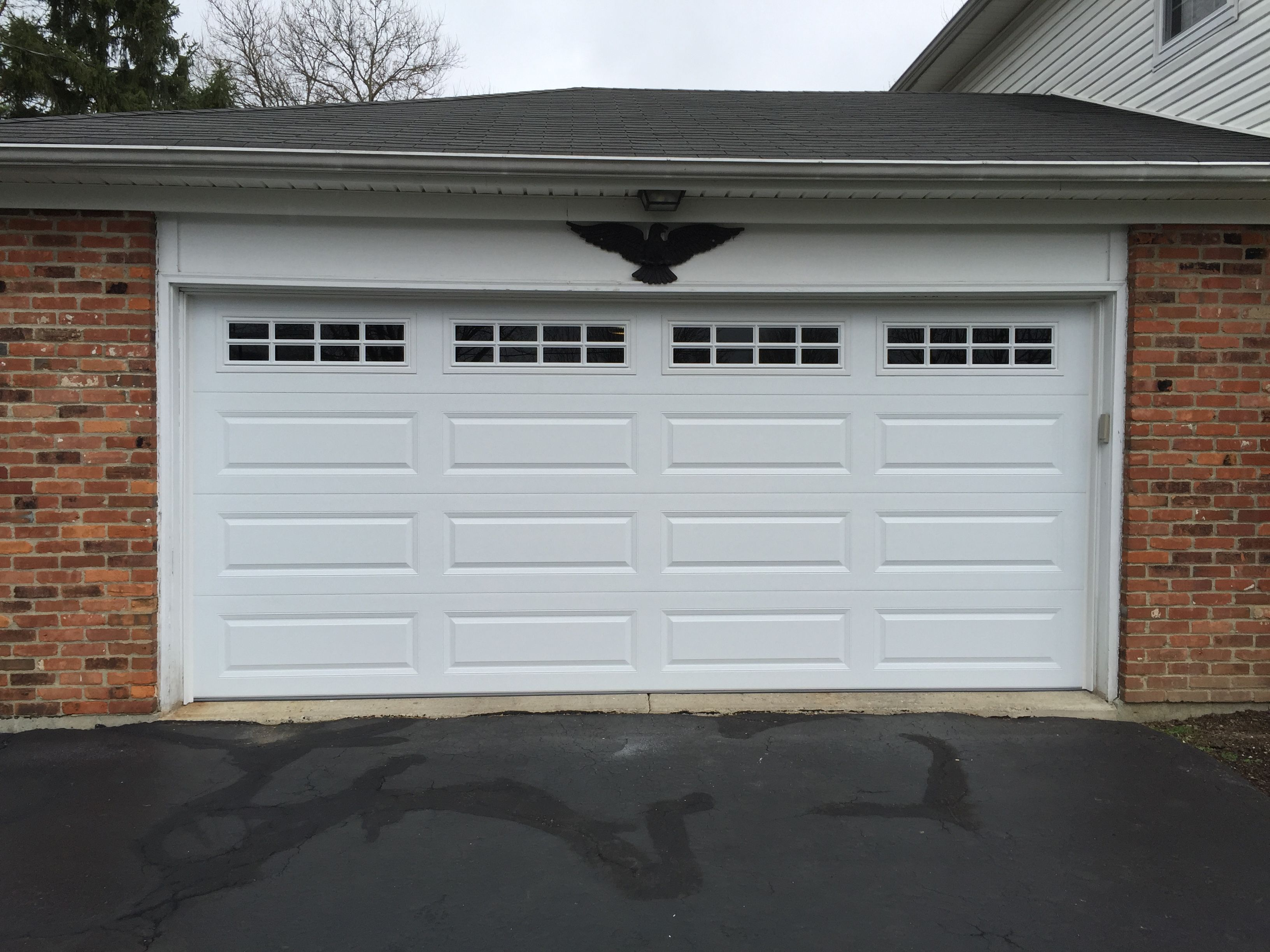 Classic C H I 4283 Long Raised Panel With Tinted Stockton Windows Garage Door Panels Door Installation Garage Doors