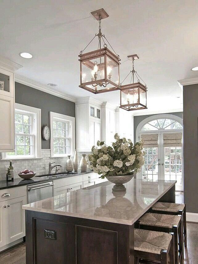 Brown Island With White Cabinets And Wood Floors Kitchen Inspirations Kitchen Remodel Sweet Home