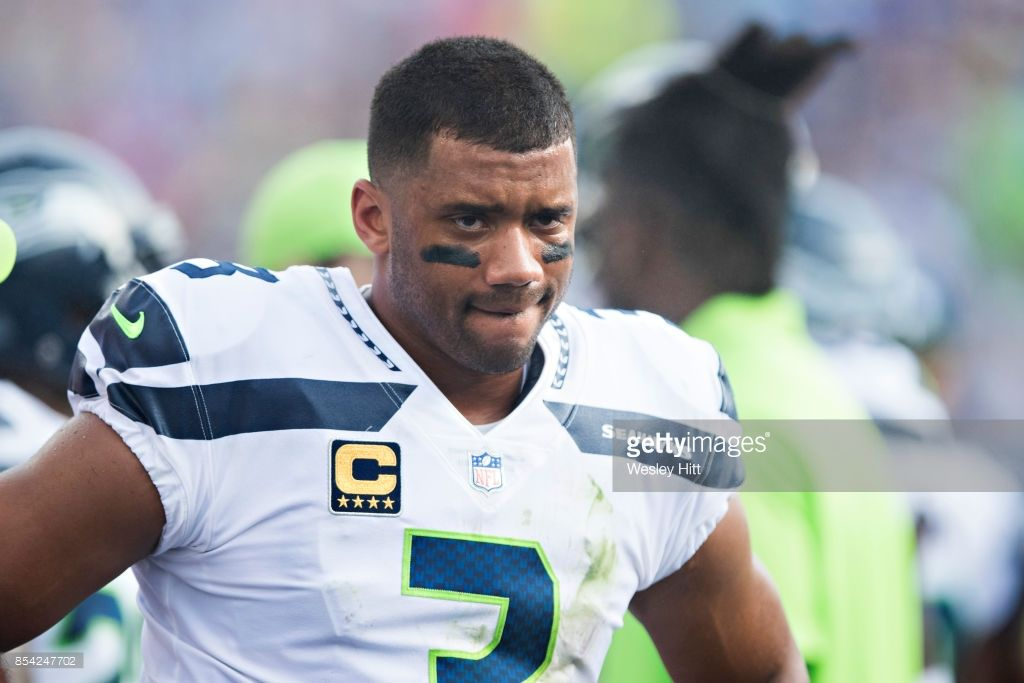 Russell Wilson Of The Seattle Seahawks On The Sidelines During A Game Russell Wilson Seattle Seahawks Doug Baldwin