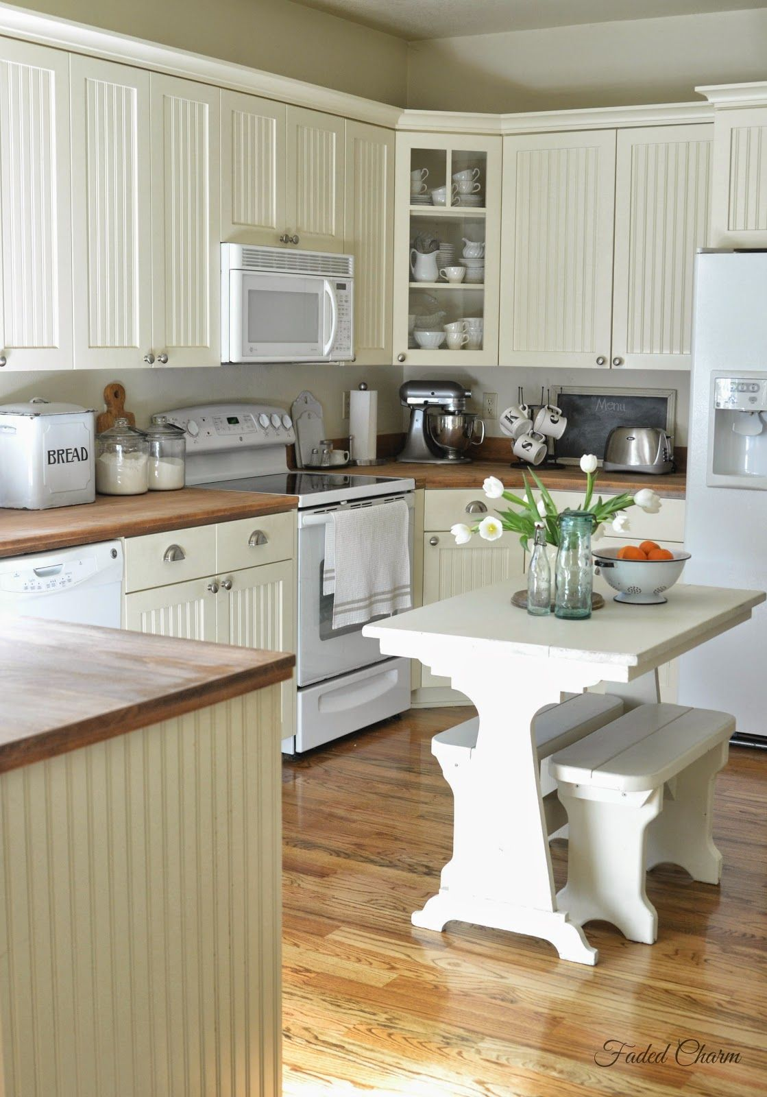 Faded Charm Farmhouse Style Love The Beadboard Cabinets Butcherblock Counter Tops Hardwood Floors And That L Kitchen Remodel New Kitchen Cabinets Kitchen