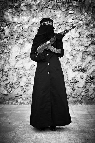 """I fight for life and freedom, I fight to prove that woman and man are equal.""  ~ Benifet Ikhla, 27 years old, widow with 6 children and a member of the Free Syrian Army   Photo by Sebastiano Tomada"