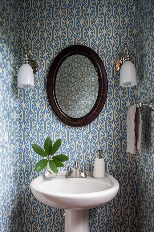 graphic wallpaper in a small powder room                                                                                                                                                                                 More
