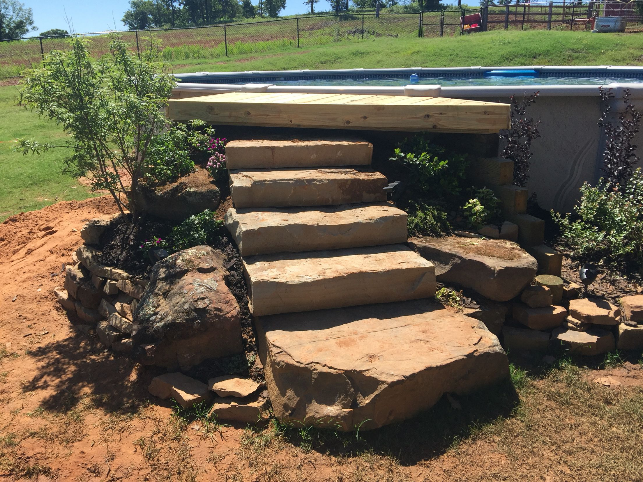 rock step entry for an above ground pool