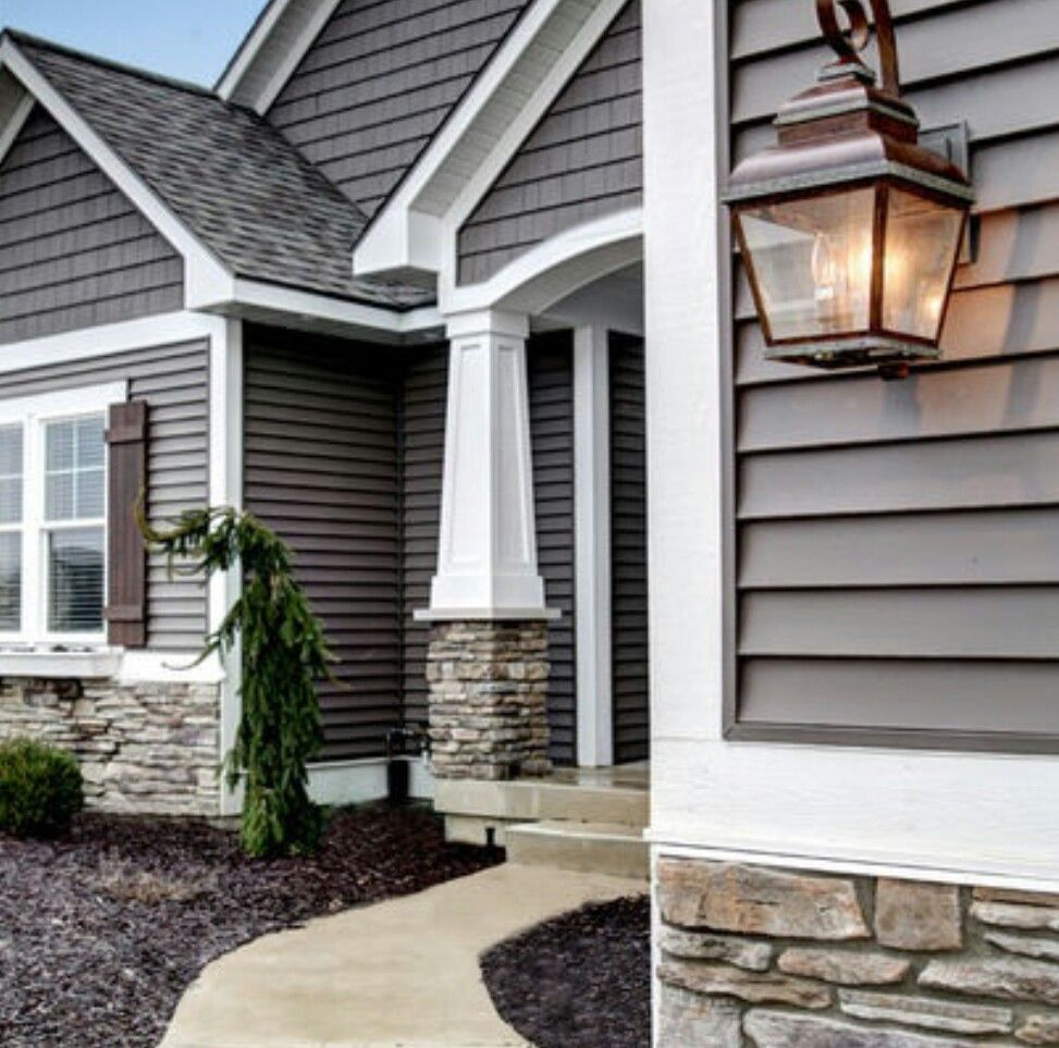 Exterior House Design With Stone And Gray, White Trim.