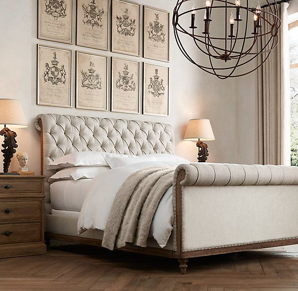 RH's Deconstructed Chesterfield Sleigh Bed With Footboard:Inspired by the unadorned beauty of their grandfather