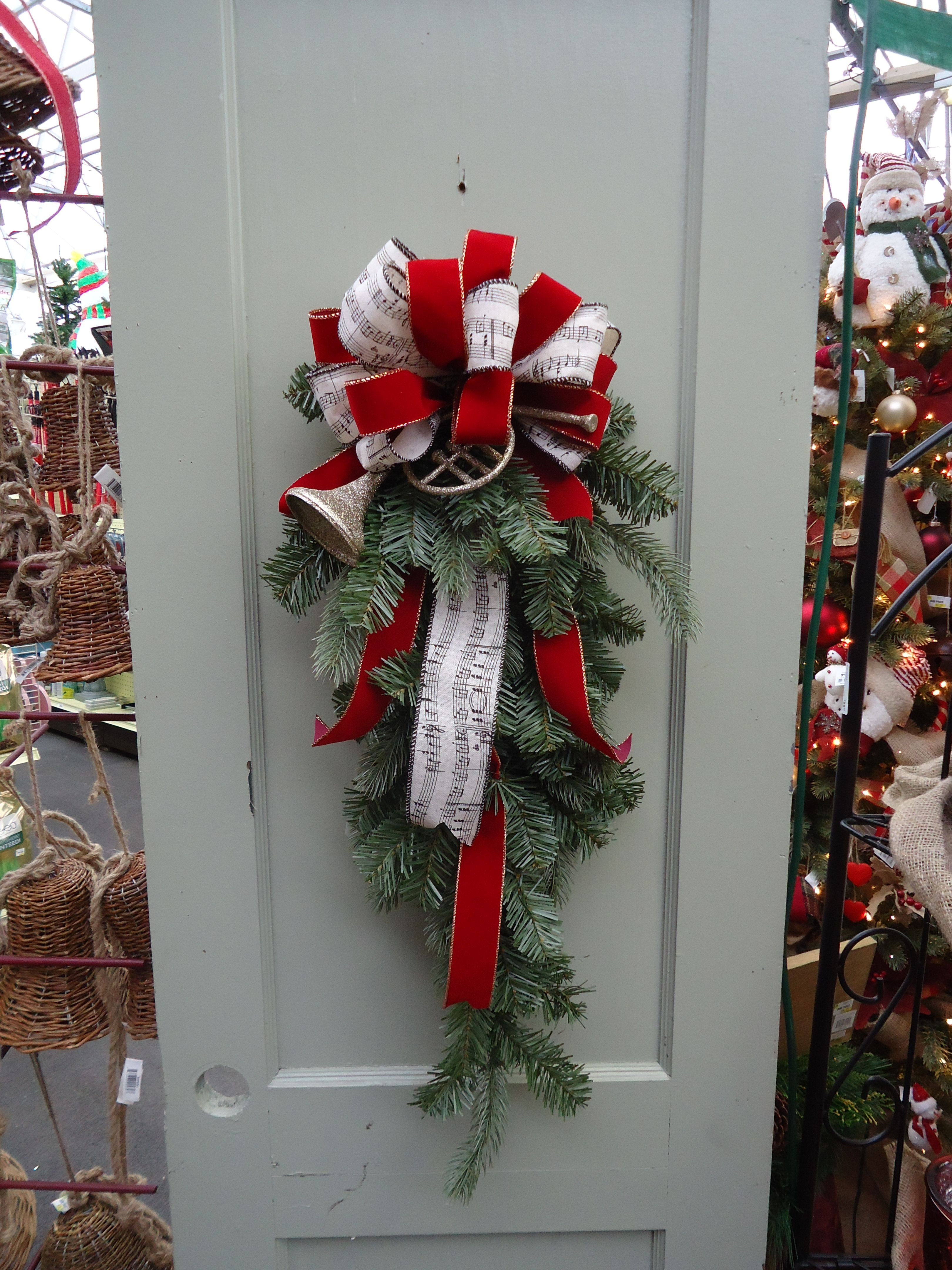 An artificial green #Christmas bow front door #wreath alternative from our Note Worthy theme at Stauffers #Hummelstown Home & Garden Store.