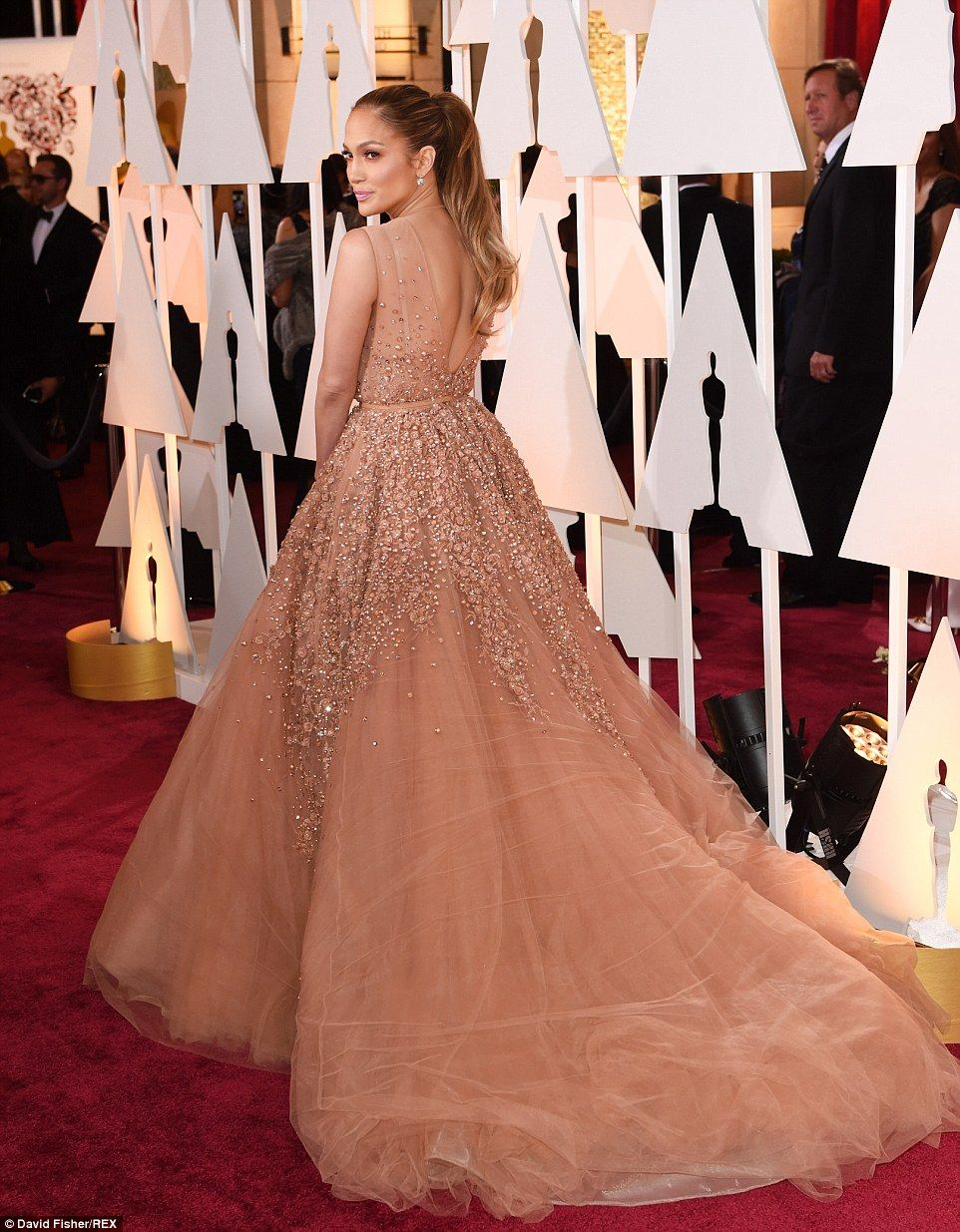Jlo battles extreme cleavage and huge train at the oscars stylish