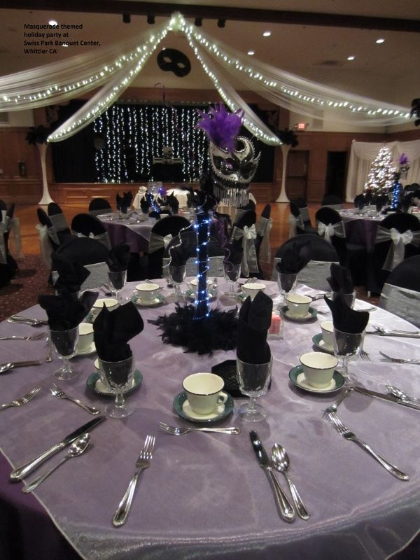 purple silver and black masquerade themed holiday party at swiss