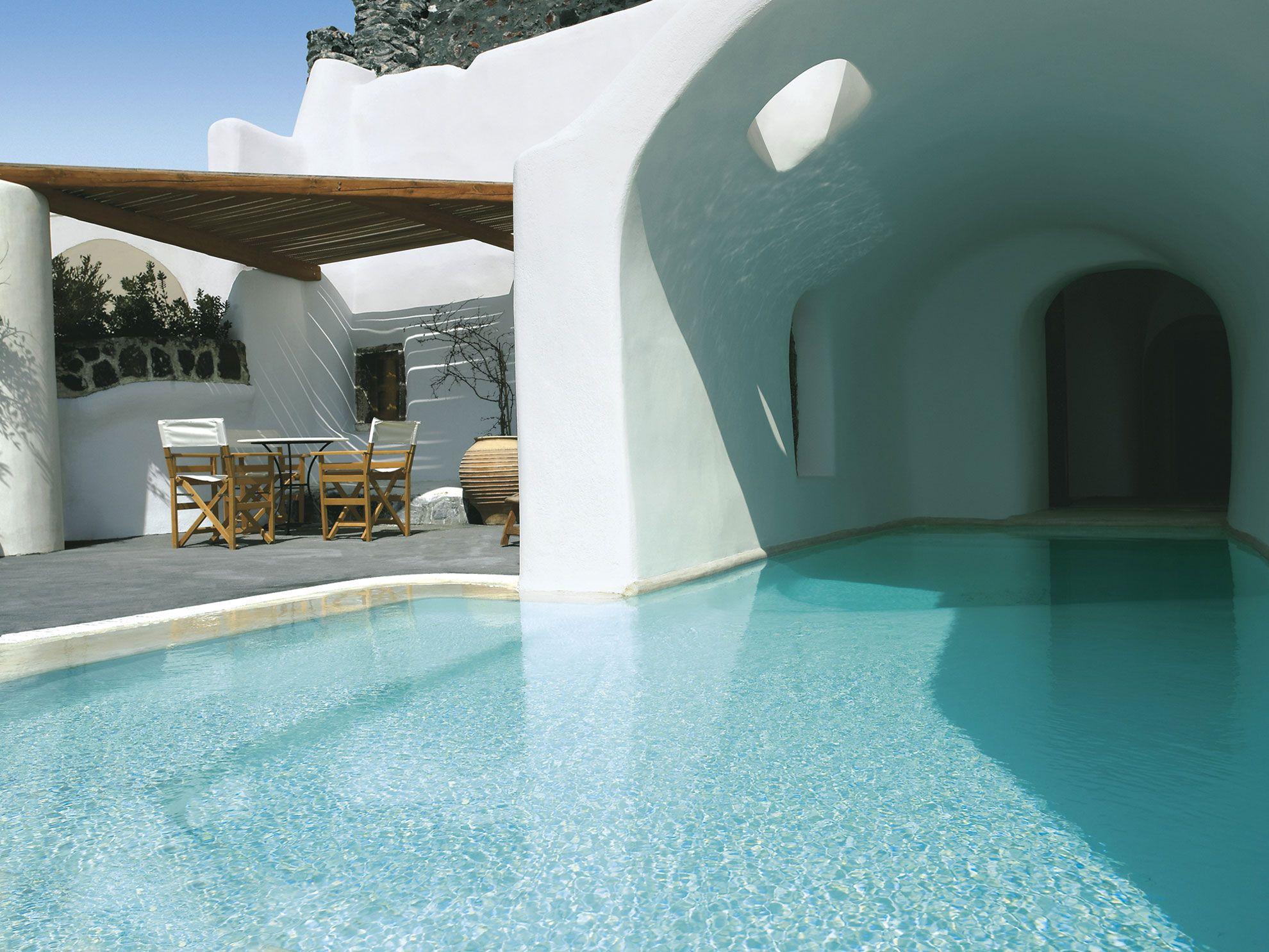 Private indoor pool suites  Perivolas Oia Santorini | Oia santorini, Outdoor pool and Volcanic ...