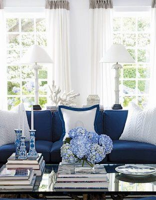 blue sofa accented with crisp white pillows