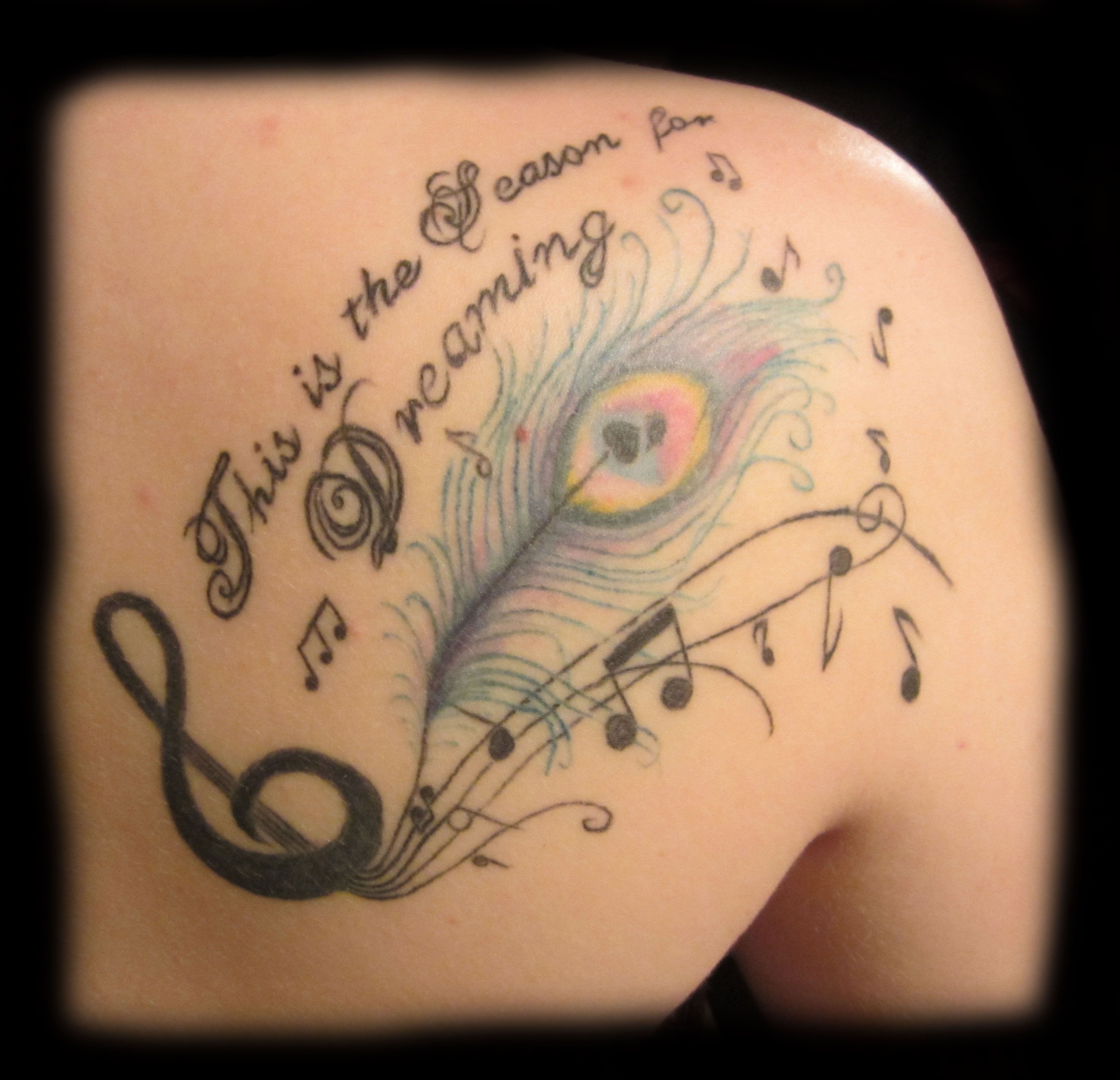 Back tattoo peacock feather music