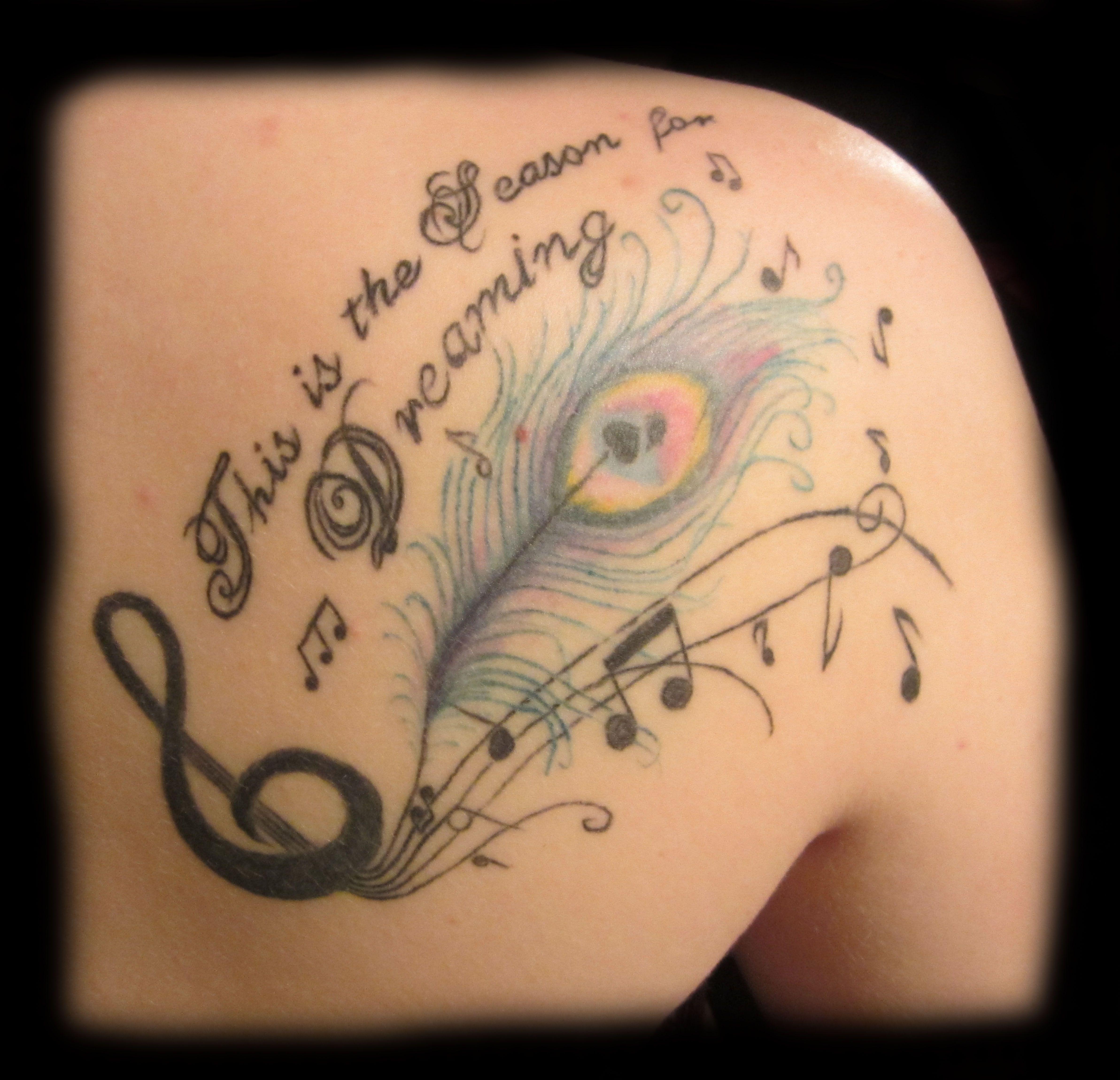 Back tattoo, peacock tattoo, feather tattoo, music tattoo