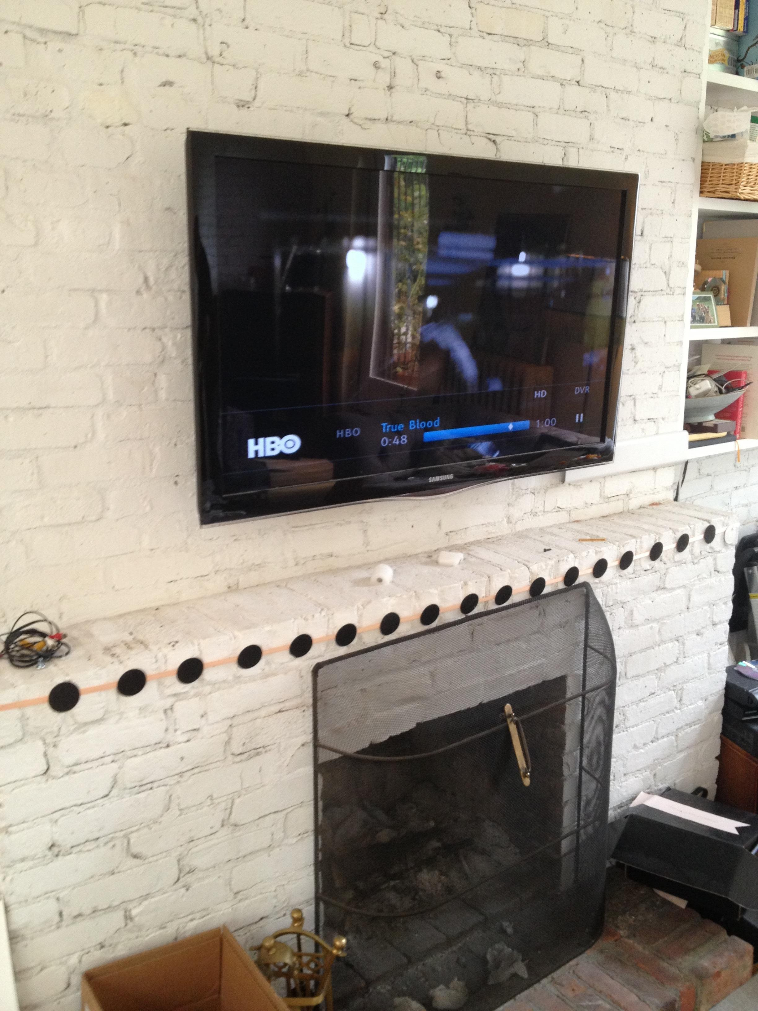 Tv Mounting Over A Brick Fireplace With Wires Concealed In Wire Molding Vesta Fireplace Tv