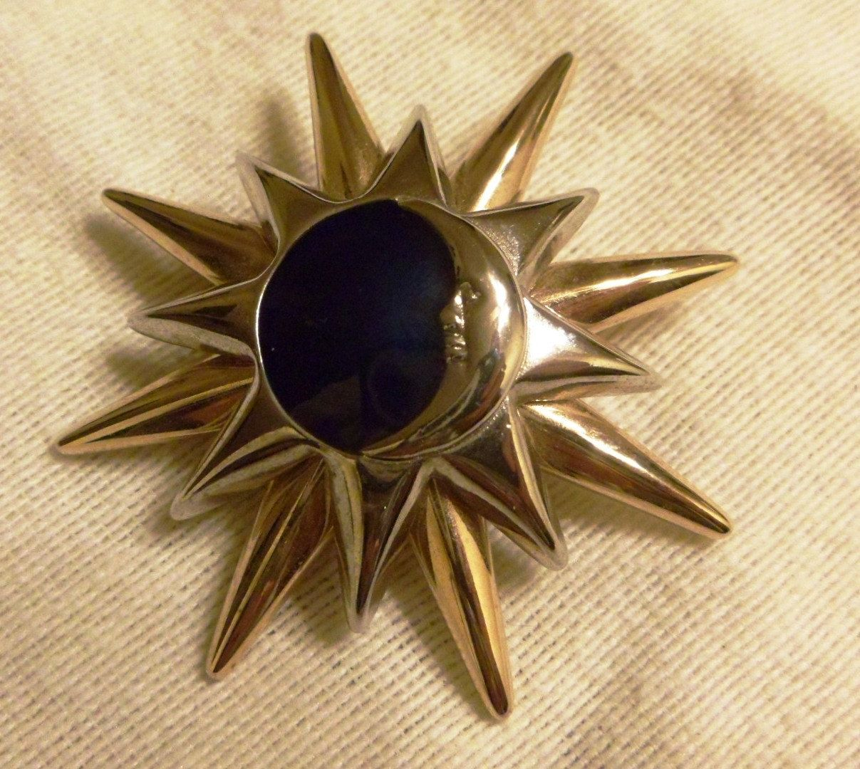 Vintage Liz Clayborn gold and silver tone sun and moon pin with midnight blue enameling. , via Etsy.
