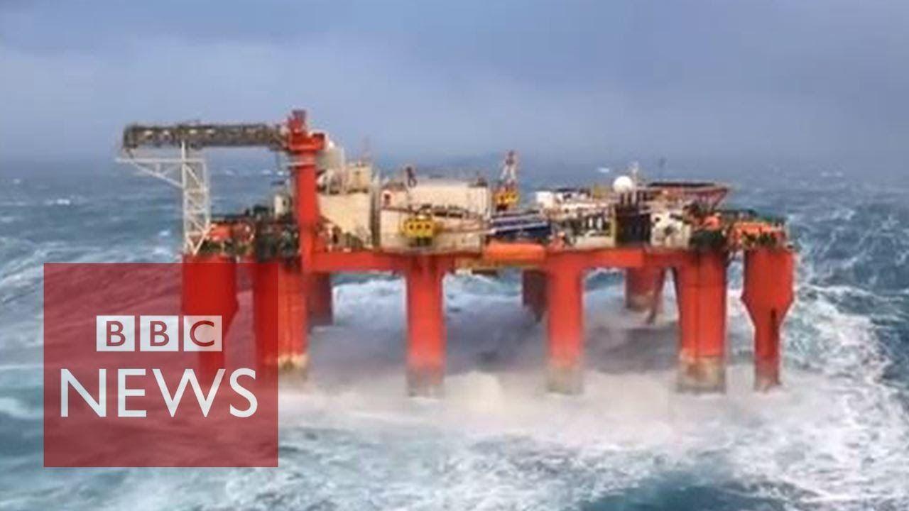 Huge waves crash against swaying North Sea oil rig - BBC News | Huge waves. Oil rig. North sea