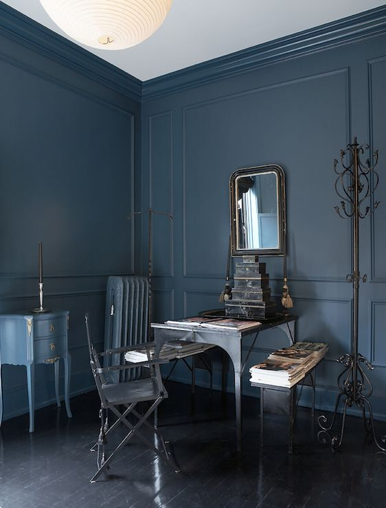Tall Ceilings Alongside Full Wall Peacock Blue Wainscoting Over Black Hardwood Floors The Office Features An Industrial Iron Desk Lined With A Matching