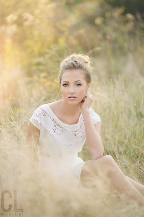 Senior Photography by Coco.laine. Girl sitting in a field