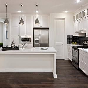 L Shaped Kitchen With White Shaker Cabinets Colonial White Granite Countertops Dark Engineered Hardwood Floors Woodsman 11 West Coast Homes