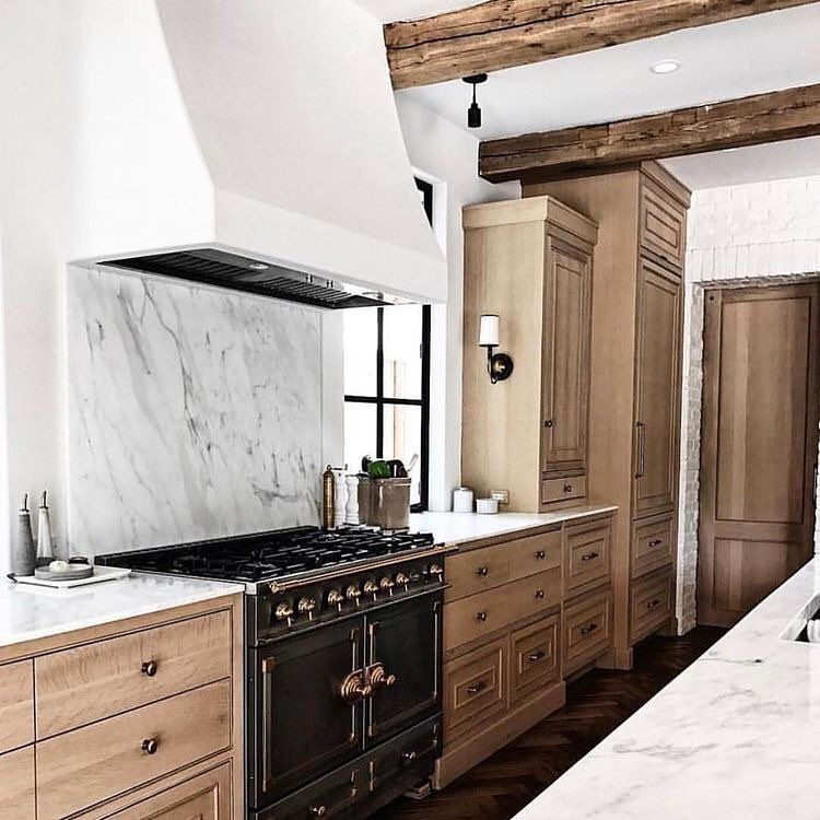 natural wood cabinets bronze hardware plaster hood marble slab backsplash black range on kitchen cabinets natural wood id=74453