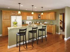 pondering how it will look to have wood cabinets after painting trim white  · Hickory Kitchen CabinetsLight ...
