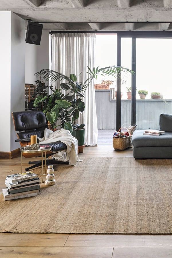 As an area rug, jute blends in well with many types of ...
