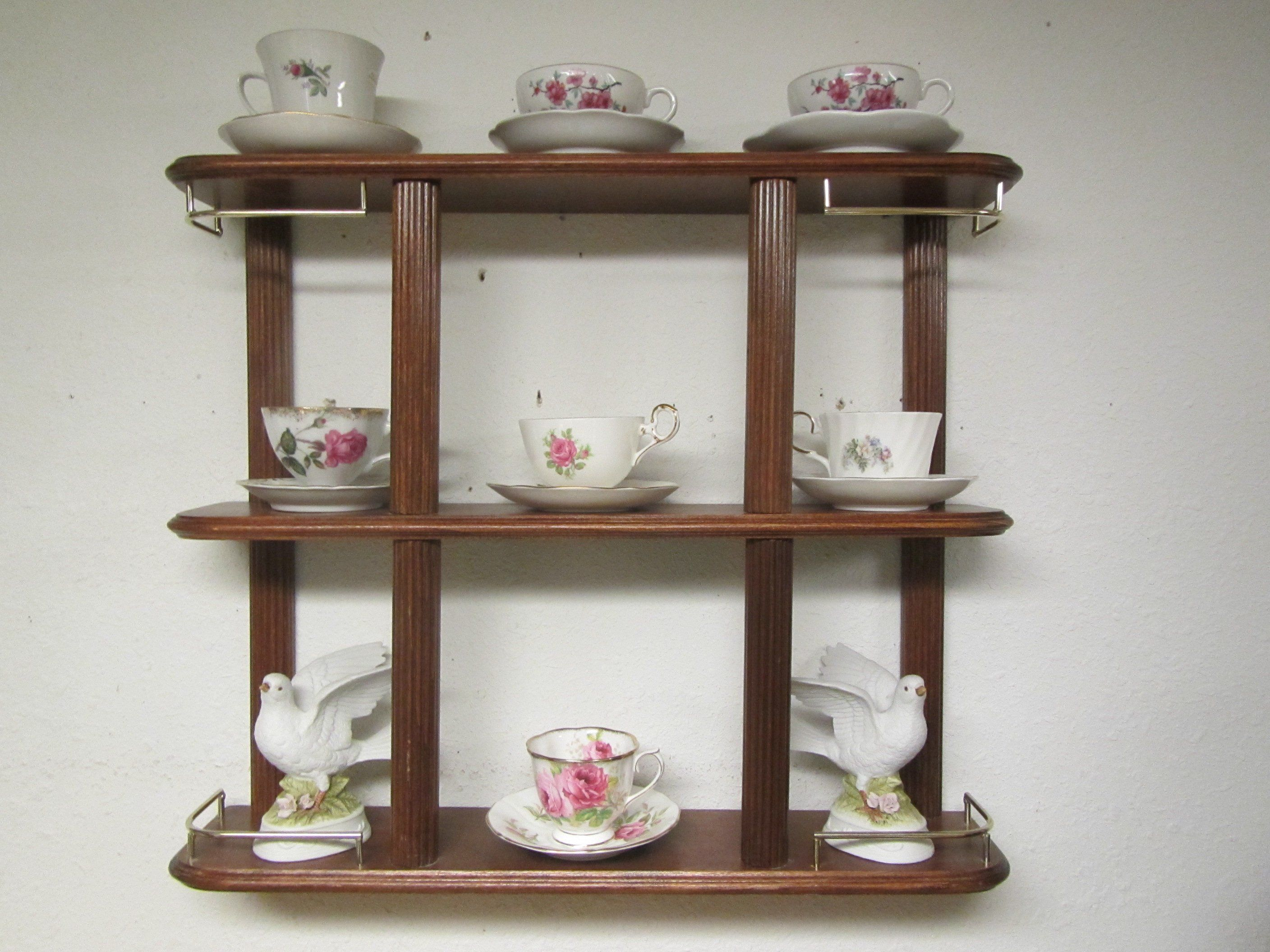 Wood Shelf With Gold Tone Rails , Cup And Saucer