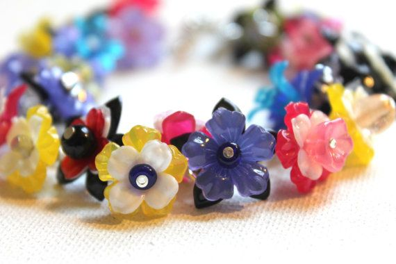 Lucite Flowers Jewelry Finding More than 60 by KimberlieKohler, $10.00  (Plus learn how to make this bracelet with these supplies on my blog!)