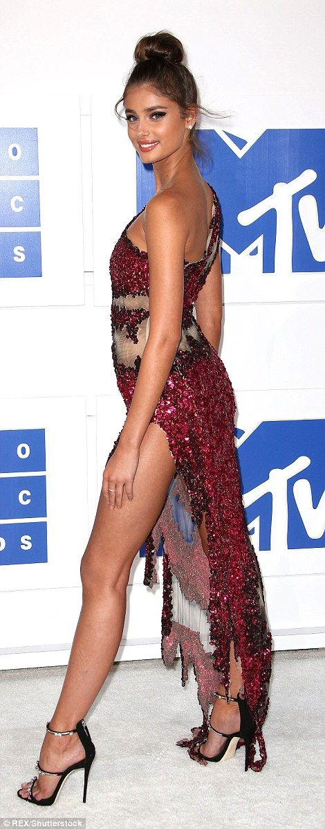 Leggy look: VS Angel Taylor Hill glittered in a red gown flashing lots of leg
