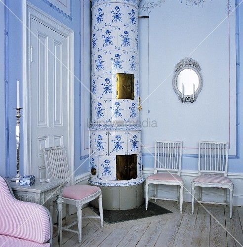living4media - a swedish wood burning stove in the corner of the master bedroom. the cylindrical kakelugnar, as it's called in swedish, is c...