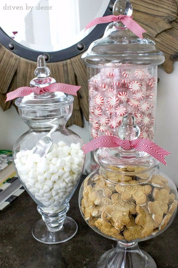 Classic New England Christmas Home Tour Apothecary jars filled with mints, mini marshmallows, and gingerbread men for the holidaysApothecary jars filled with mints, mini marshmallows, and gingerbread men for the holidays