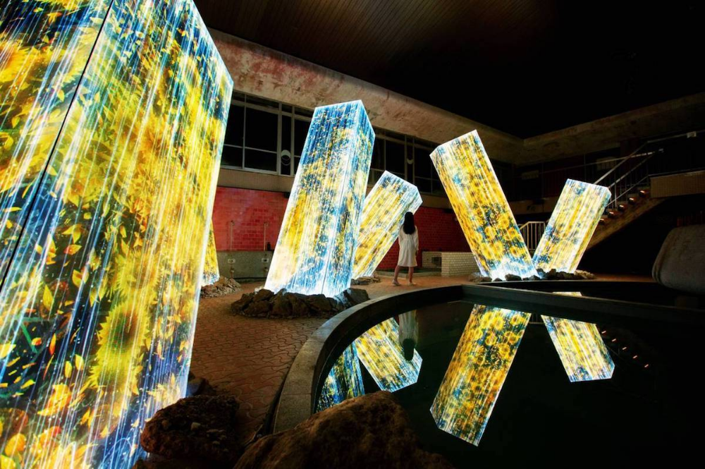 Immersive Nature Art Projections Emerge on Megaliths in a Japanese Bath House #lightartinstallation
