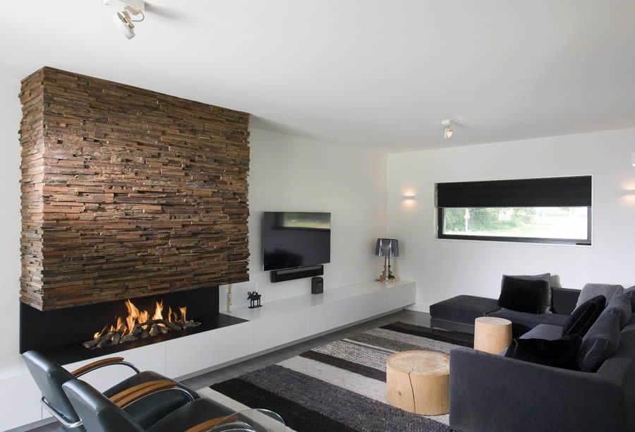 Wohnzimmerwand Holz ~ Kaminverkleidung mit alten bahnschwellen kaminverkleidungen