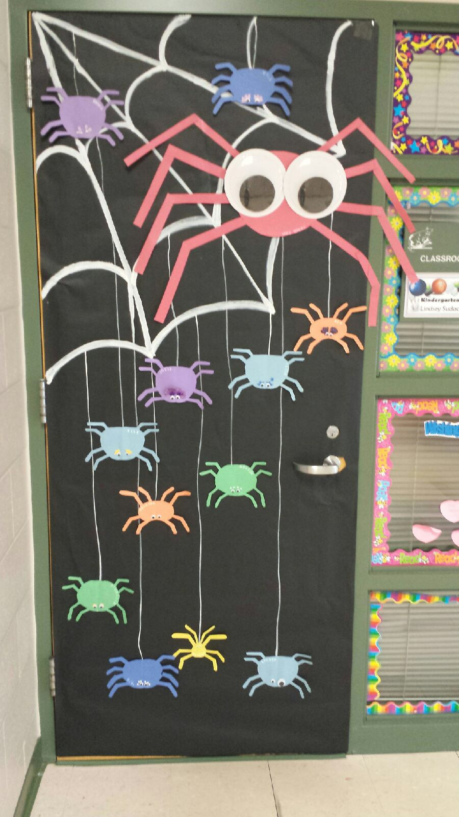 Spider door. The small spiders say each kid's name and the big spider is our wonderful teacher. #halloweenclassroomdoor