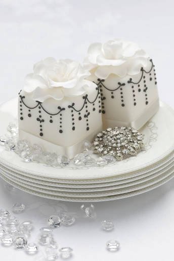 Treat your guest with individual cakes topped with iced blooms and decorated with jewels.