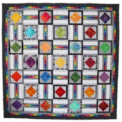 Easy lap and throw, queen or king size. Scrap friendly. Uptown Squares Quilt Pattern PAD-155 by Presto Avenue Designs by Claudia Lash.  Check out our modern quilt patterns. https://www.pinterest.com/quiltwomancom/modern-quilts/  Subscribe to our mailing list for updates on new patterns and sales! https://visitor.constantcontact.com/manage/optin?v=001nInsvTYVCuDEFMt6NnF5AZm5OdNtzij2ua4k-qgFIzX6B22GyGeBWSrTG2Of_W0RDlB-QaVpNqTrhbz9y39jbLrD2dlEPkoHf_P3E6E5nBNVQNAEUs-xVA%3D%3D