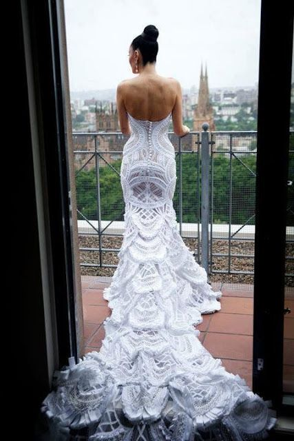 Insanely beautiful, backless crocheted wedding gown.  I came across this photo uploaded by a user on Pinterest and tried (unsuccessfully) to find out where it originated from and who the maker was.  It is nothing short of spectacular!  I'm in love.
