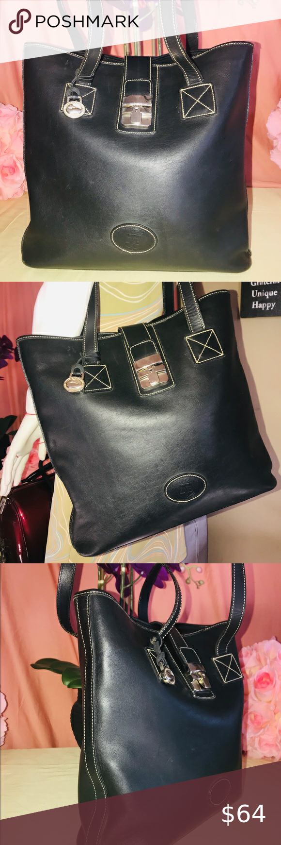 Dooney & Bourke 0909P Black Medium Shopper Bag Dooney & Bourke 0909P Black Medium Shopper Bag In Excellent Preowned Condition   • Silver Hardware  • Flap + Lock Closure • IMPORTANT: Added coffee pouches to remove mild cigarette odor. Will ship with the bag • Normal Signs Of Wear  • No Holes or Tears  • Ship Same or Next Business Day • Reasonable Offers Welcome  • Satisfaction Guaranteed Dooney & Bourke Bags Totes
