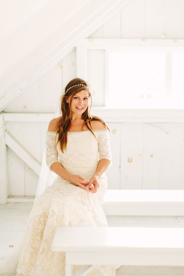 white lace wedding gown by Rivini