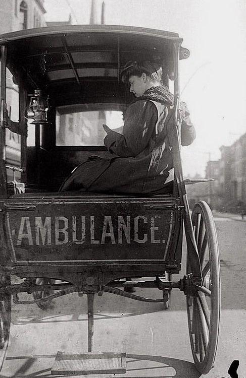 Dr. Elizabeth Bruyn, sitting in the back of a horse drawn ambulance, 1900.