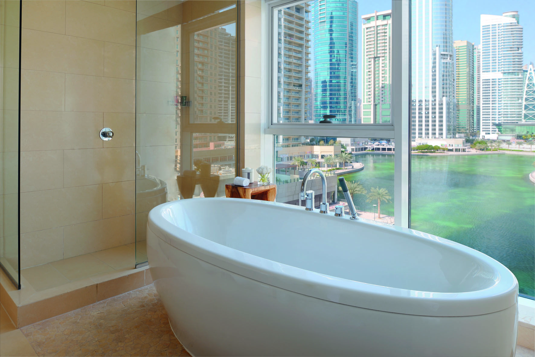 Bathroom with a view. | Mövenpick Hotel Jumeirah Lakes Towers ...