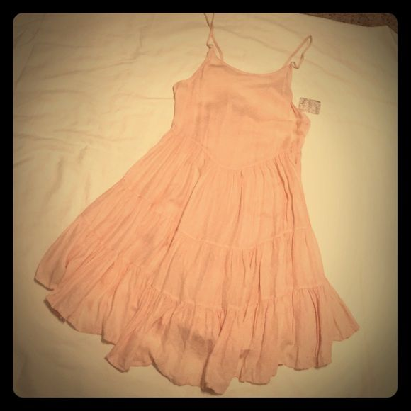 Intimately Free People light pink slip dress Super cute flowey Free People slip dress. Perfect for spring festival season. NWT but there are 2 teeny tiny pulls in front near left strap. Very light pink with tiny white flower print. Fabric is super soft. Totally adjustable lace up back. Free People Intimates & Sleepwear Chemises & Slips