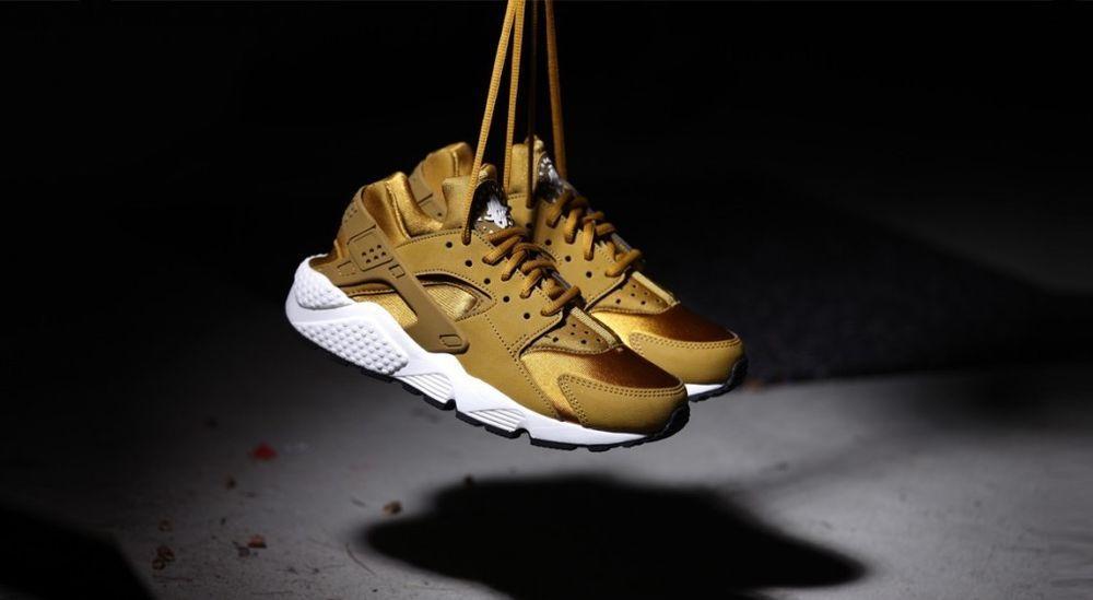 ceeae6f9f0d9 women s gold huaraches. Nike.